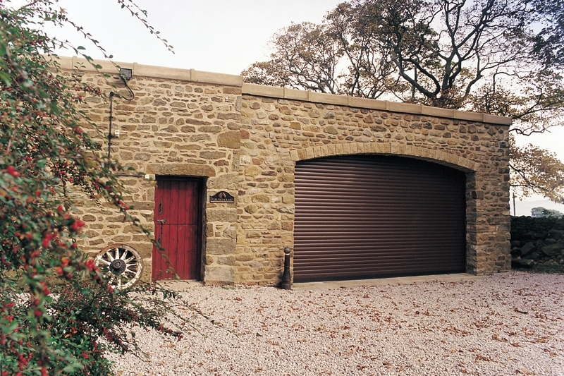 A brown manual operated roller garage door