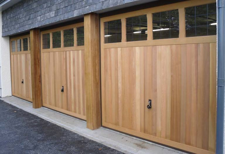 Electrically operated Retractable Timber Doors. Fitted with plain crossed windows