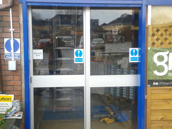 Automated doors installed by Zenith Doors at the front of a shop