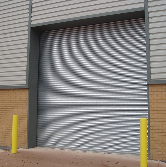 A grey roller shutter door installed on an industrial property